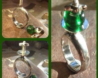 Hand made sterling silver and green glass bead ring.
