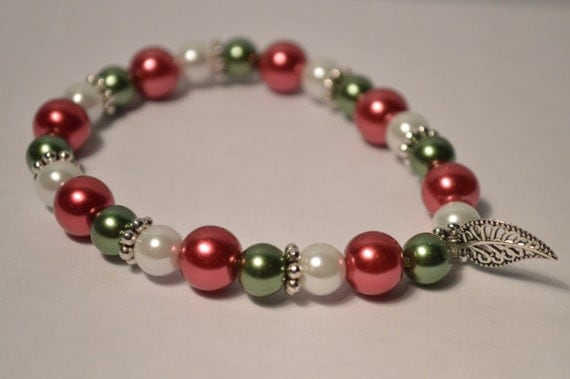 Items similar to christmas beaded charm bracelet glass