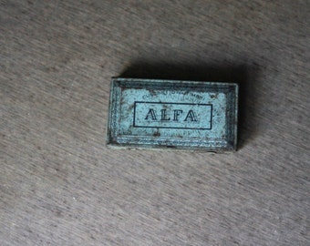 buffer, cuscientto for vintage stamps. light blue, dark blue. in metal