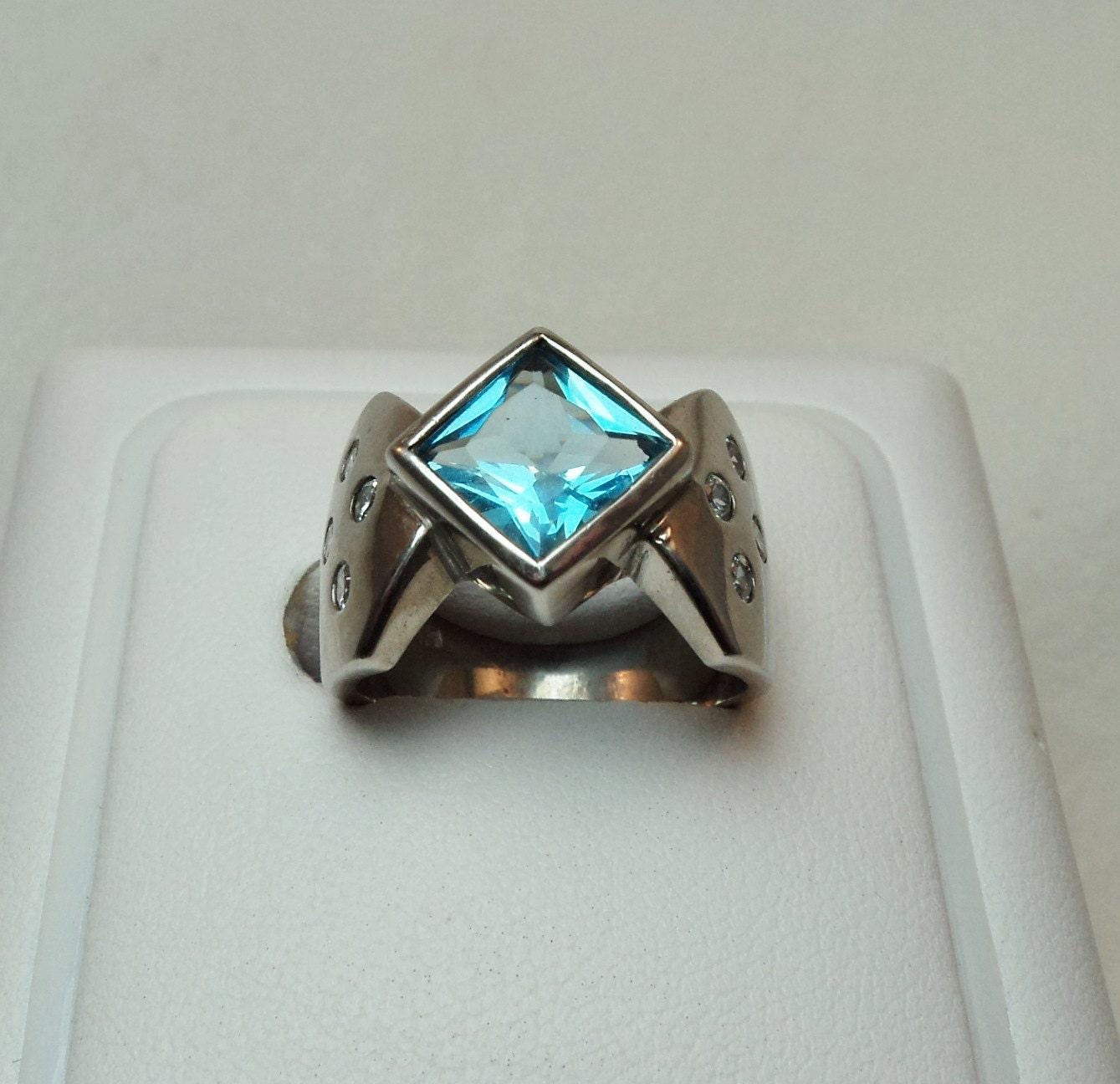 unique princess cut blue topaz ring by