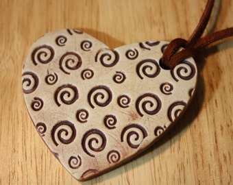 Brown suede cording heart shaped ceramic pendant 30 inch N 385