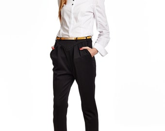 Black pants, folded front side, pockets