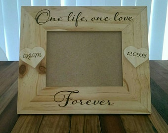Personalised wooden photo frame.