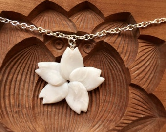 White pearlescent sakura flower pendant necklace