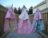 pink toy ring sling, toddler-sized 2-5 years, plaid gingham parrots, doll carrier, over-the-shoulder, ready to ship, attachment parenting