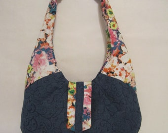 Handmade denim and multi-floral handbag.