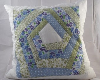 White, blue and green floral patchwork cushion