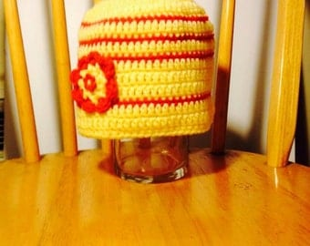 Yellow and orange hat with yellow flower and orange button for little girls six to twelve years old . . .