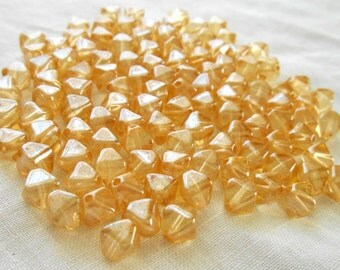 50 6mm Crystal Champagne bicone beads, pressed glass Czech beads, C5350