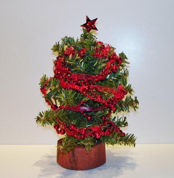 Mini christmas tree red ribbon for Red ribbon around tree
