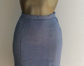 The 1960's Lady at Work in the Summer Chequered Skirt.