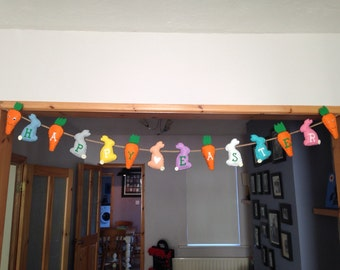 Happy easter bunting. Coloured felt bunnies and carrots