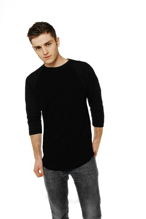 Baseball tees are a great way to incorporate some color blocking into a sporty, casual look. In fashion terms, this shirt style is typically a 3/4 sleeve shirt that features sleeves and a collar ring that are a different color than the shirt's body.