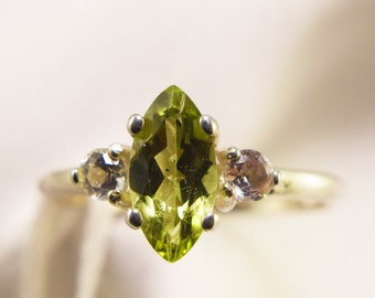 Marquise Peridot Ring With Topaz Side Stones
