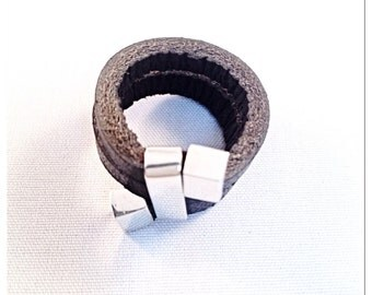 Silver and leather ring.2 times around.
