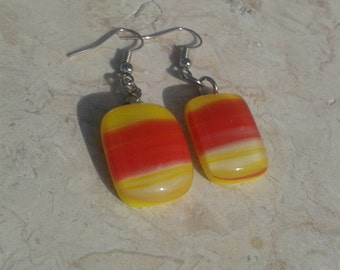 Unique vibrant fused glass earrings made of red and yellow glass