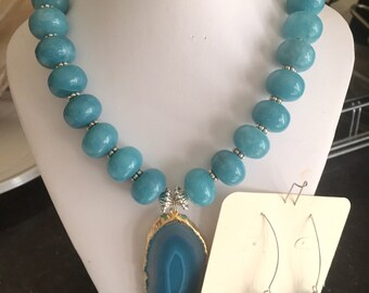 Beautiful Teal necklace with a handmade glass pendant