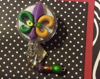 Mardi Gras purple, yellow and green flleur de lis retractable badge holder