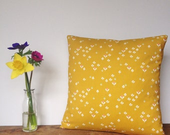 Mustard yellow, floral cushion, feather insert included.