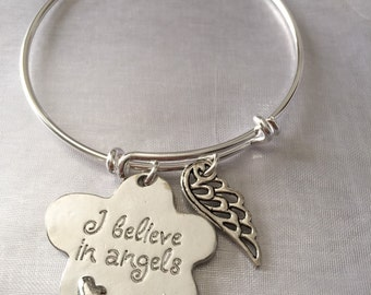 """Angels-bracelet with wing and stamped """"i believe in angels""""charms"""