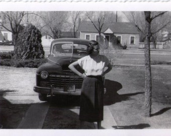 Vintage photo of woman and car, retro photo, nostalgic photo, paper ephemera, snapshot, vernacular photo, black and white photo, old photo