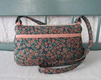 Small fabric handbag with zipper closure and shoulder strap