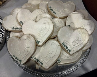 Personalized heart shaped sugar cookie. Decorated with your choice of color, inscription and finish.