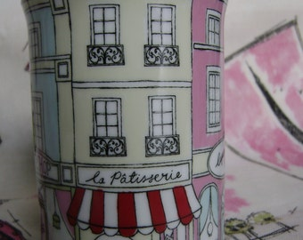Mug with mid-century style drawings- patisserie with red striped awning,bakery,cafe,tea-shop.Black outline on pink,pastel blue,yellowy cream