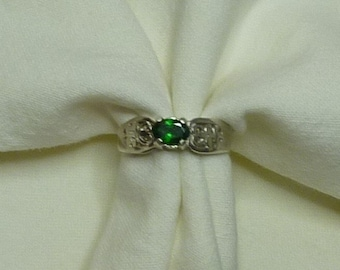 6mm x4mm oval cut .50 ct tsavorite garnet sterling silver ring size 7.5