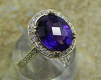 AAA Brazilian Amethyst 2.51 Carats 10 X 8mm. in a 14k Yellow gold ring with diamonds (.32ct) Ring 1814 MMM
