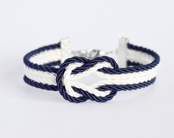 Navy blue and ivory cream forever knot nautical rope bracelet with silver anchor charm