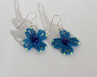 Blue Flower Earrings with Green Accents