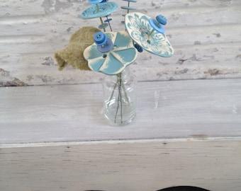 carolina blue button flower bottle bouquet