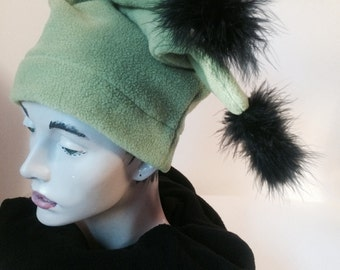 Green fleece hat trimmed in Black feathers.