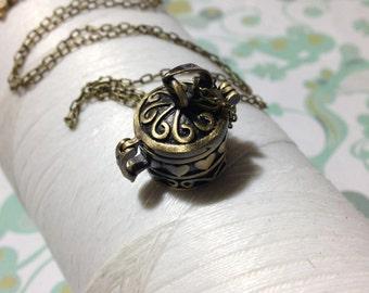 Worry Locket - round memory box / prayer box / keepsake locket / round locket / memory locket / seed necklace / sea glass necklace