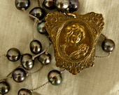 Romantic Vintage Brass Cameo With Knotted Black Pearls