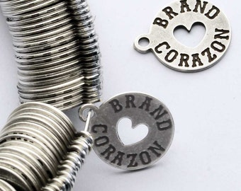 200 pcs Round Metal Tag with symbol cut-out. 9.5 x 9.5 mm. 90 sq mm. Customized