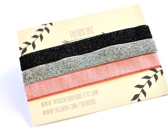 Ballerina Glitter stretch bands in black, silver and frosted pink. 3 headbands in a set. TutusChic is everyday glamour.