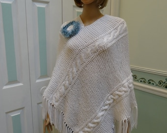 WHITE CABLE PONCHO, up to plus size and maternity sized, with removable brooch , hand knitted, 5 inch fringe, fits size 10 to 16
