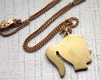 1950s Brass Ponytail Girl Pendant Necklace // Retro Pin Up // Handmade Vintage Novelty Necklace