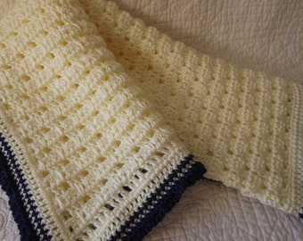 Crocheted Super Soft Baby Blanket in Cream with a Navy Blue Edge