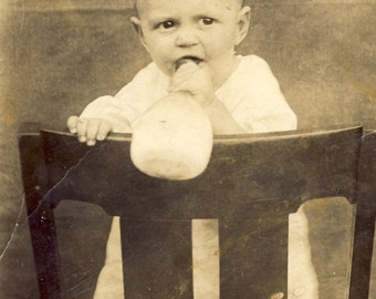 Toddler Drinking From His ANTIQUE BABY BOTTLE While Standing On a Chair Photo Postcard Circa 1910