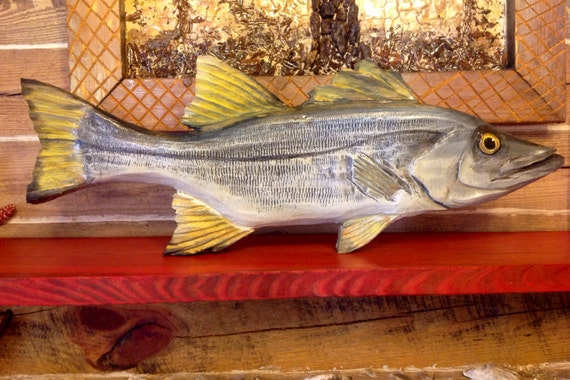 Snook wooden fish chainsaw carving ocean coastal fly