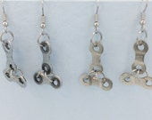 Bicycle chain earrings silver coloured