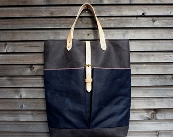 Diaper bag in waxed canvas  with  leather handles and double waxed canvas bottem COLLECTION UNISEX