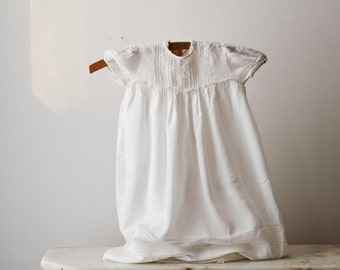White batiste childrens dress with pintucks