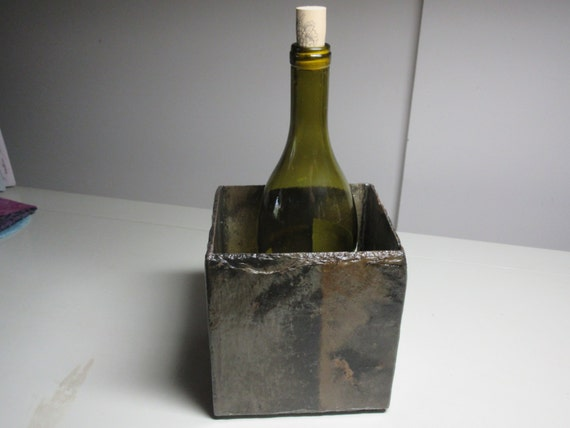 Wine bottle holder keeps things cool made from by for Cool things to do with a wine bottle
