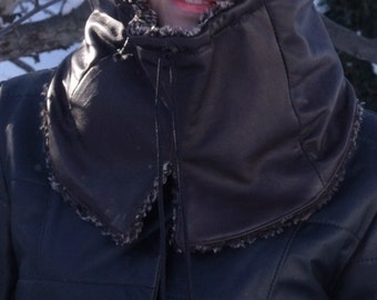 Upcycled leather hood with pompon