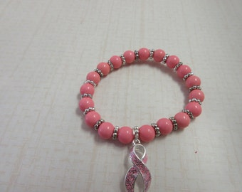 A Bracelet with a purpose.  Pink Breast Cancer Beaded bracelet with pink charm.