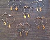 Raw Brass Crescent Moon and Star Hoop dangles. simple moon and star earrings. minimalist earrings. modern earrings. celestial jewelry.